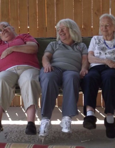 Residents enjoying the outdoor space at Casa de Paz assisted living